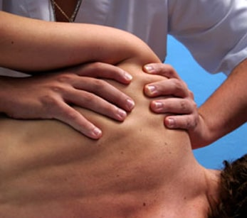 Sports massage technique on a shoulder