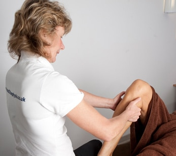Sports massage for tight calf muscles